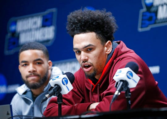 New Mexico State's Eli Chuha, right, and Shunn Buchanan, left, speak during a news conference at the NCAA men's college basketball tournament Wednesday, March 20, 2019, in Salt Lake City.