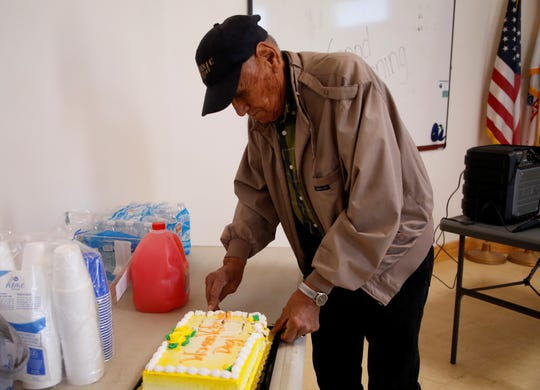 Tsé Daa K'aan Chapter Veterans Organization Commander Paul George cuts a piece of cake during an event to recognize women veterans on Wednesday at the Northern Navajo Veterans Center in Shiprock.