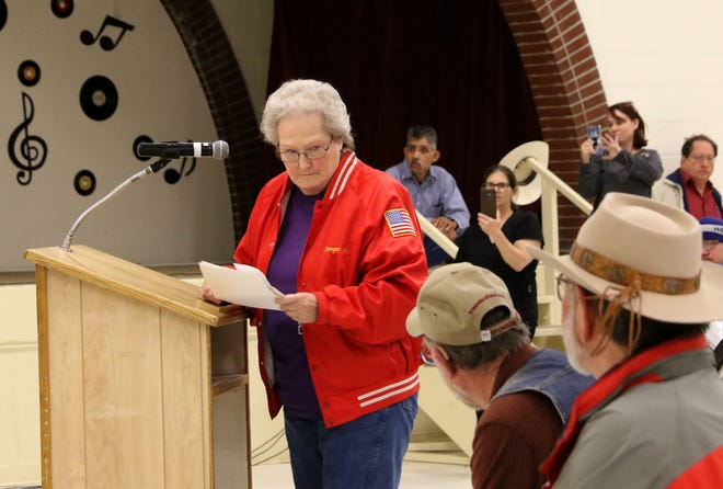 Diana Mesch prepares to leave the podium Tuesday after speaking against gun control measures during a public forum at the Aztec Senior-Community Center.