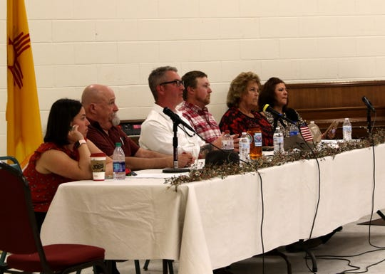 From left, Aztec City Attorney Nicci Unsicker, Commissioner Mark Lewis, Mayor Victor Snover, Commissioner Austin Randall, Commissioner Sherri Sipe and City Clerk Karla Sayler listen to comments Tuesday during a public forum about the Second Amendment at Aztec Senior-Community Center.