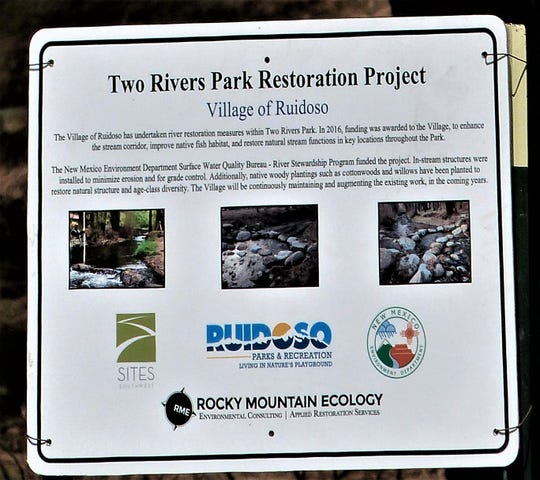 Signs were posted in the park to explain the work to the public.