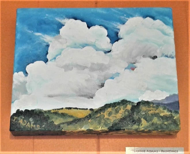 Adams captures the sky and mountains of New Mexico.