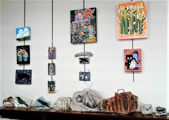 Paintings are displayed illustrating Jeannie Adams' various approaches.