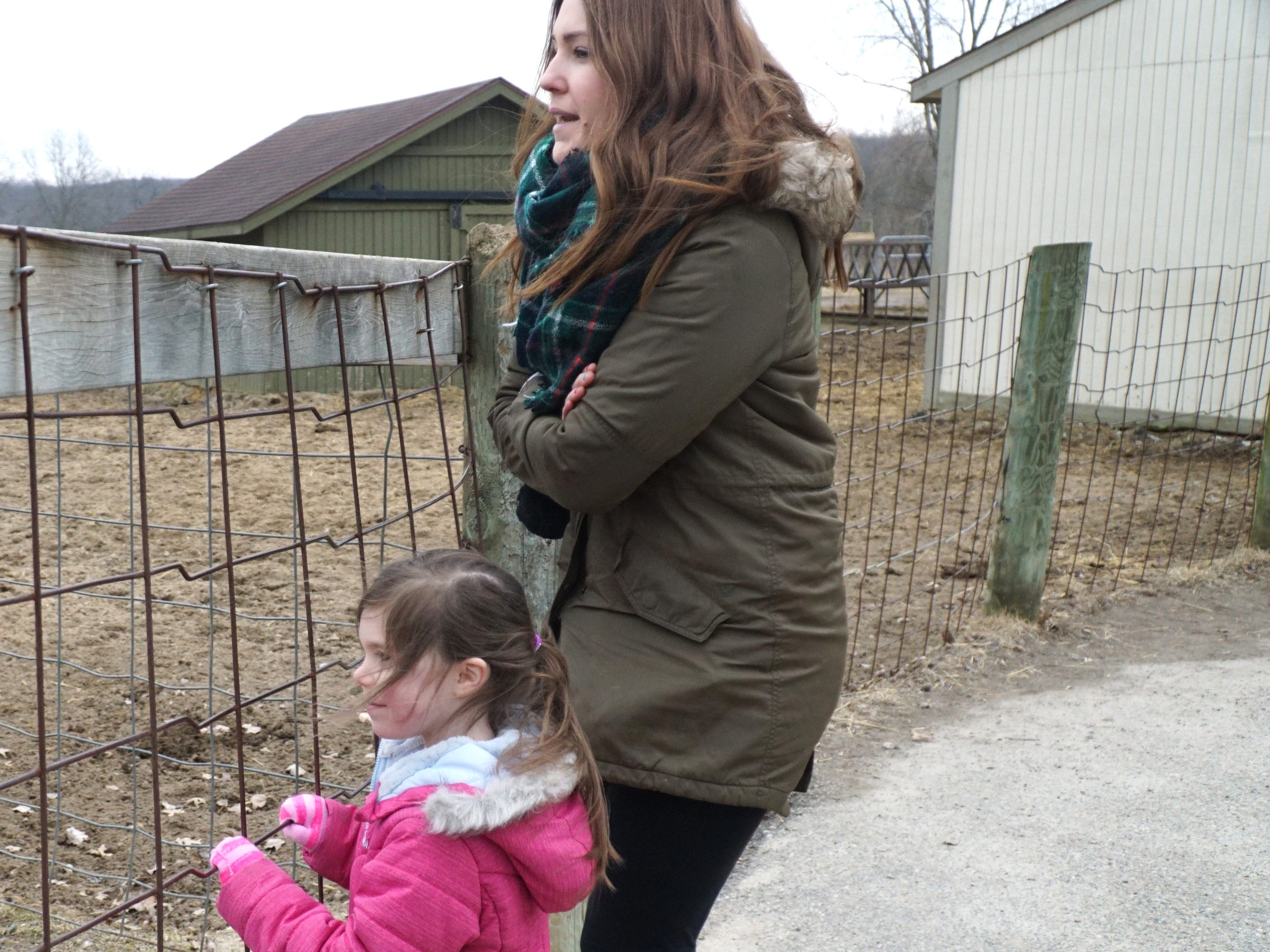 Megan Geldardi and her daughter Mia, 4, take a look at a pair of young Belgian plow horses at Kensington on March 20.