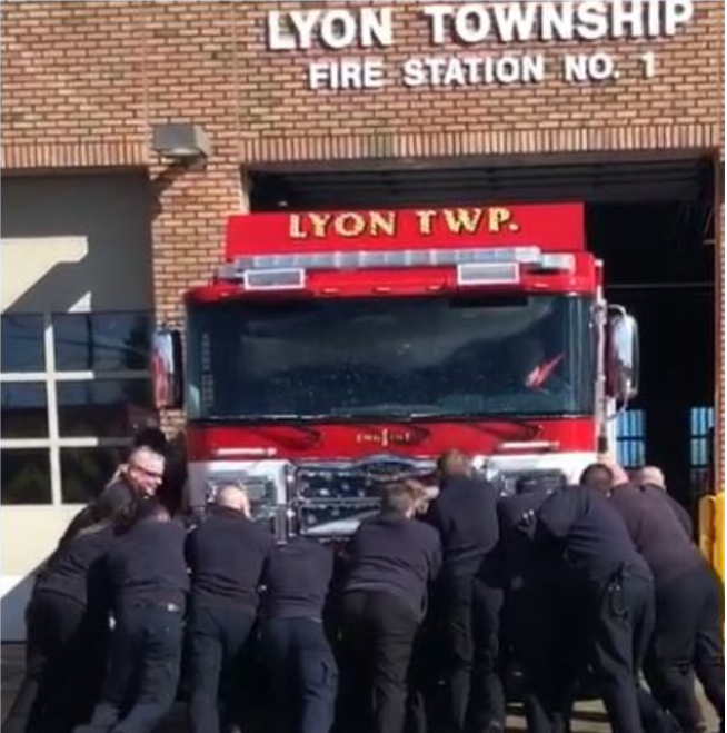 Lyon Township dedicates new fire engine with old-fashioned push back ceremony