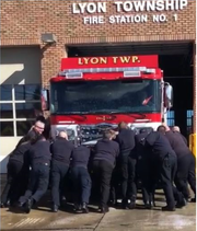 Lyon Township firefighters push their new engine into the station on Saturday, March 16, 2019.