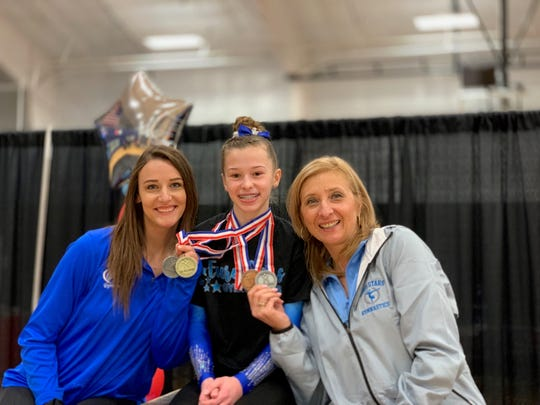 Northville middle school gymnast Sophia Reddy is the level nine state champion on bars.