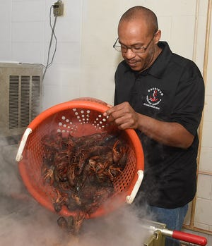 Mr. T. prepares to boil crawfish for the grand opening of Eddie's Seafood Market in Opelousas.