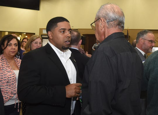 District 40 State Representative Dustin Miller (left) speaks with Opelousas businessman Pat Fontenot during a Tuesday night gathering in which Miller announced his 2019 reelection campaign.