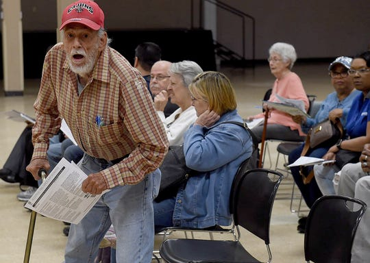 An Opelousas resident waits for his name to be called as he takes advantage of the annual free tax service offered by Ledricka Thierry.