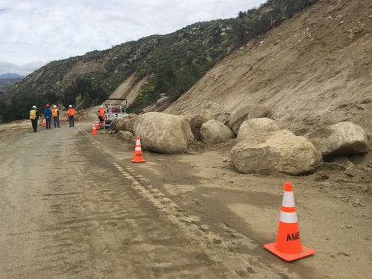 Boulders block a portion of Highway 74 near Hemet on March 20. Officials announced escorted access may begin toward the end of April after the road shut down due to a Feb. 14 rainstorm.