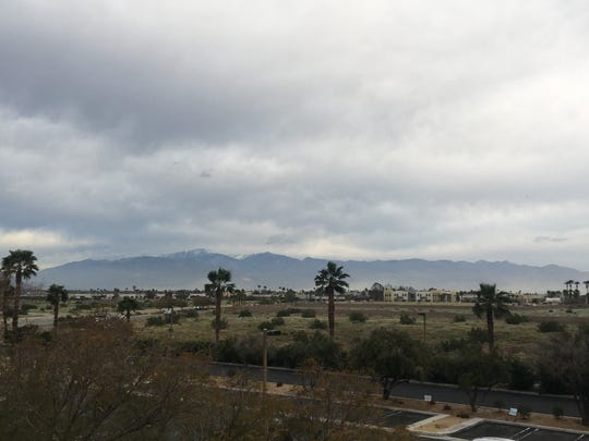 Gray clouds are visible above the Coachella Valley Wednesday. Light amounts of rain are expected before the area clears up Thursday, forecasters say.
