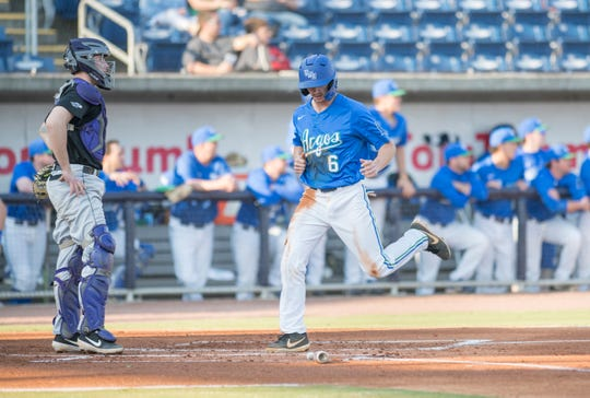 Dylan Menhennett (6) crosses home as the Argos take a 1-0 lead during the University of Wisconsin-Whitewater vs University of West Florida baseball game at Blue Wahoos Stadium in Pensacola on Wednesday, March 20, 2019.
