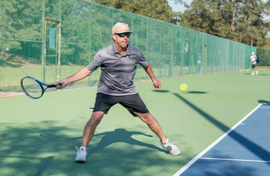 Chris Loring plays tennis at Bayview Park in Pensacola on Tuesday, March 19, 2019.