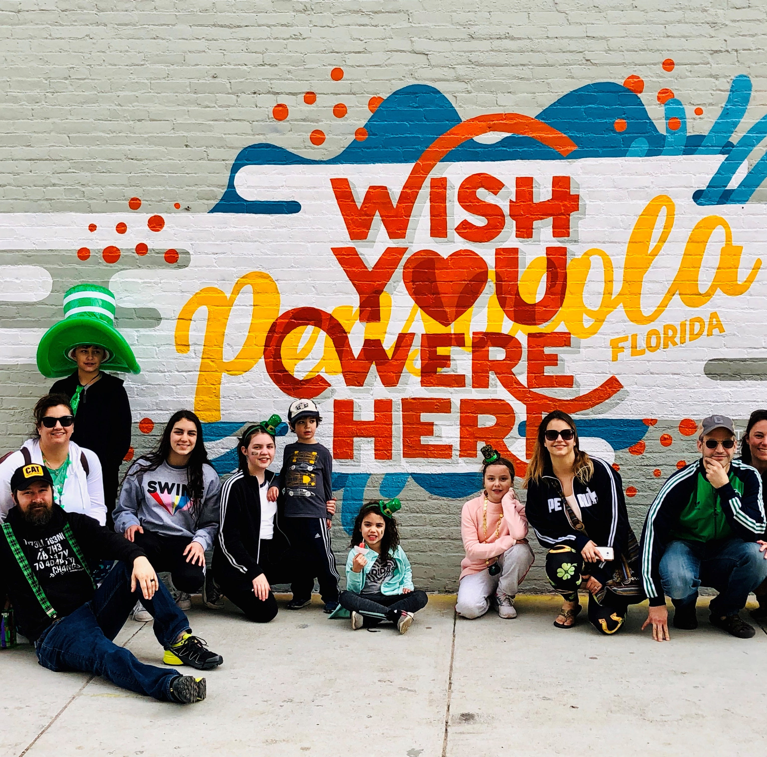Artist duo creates Pensacola-themed downtown mural on Zarzaur Law building