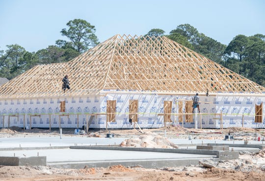 Houses under construction in The Waters subdivision off Soundside Drive in Santa Rosa County on Wednesday, March 20, 2019.
