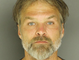Michael Allen Zinneman, born on 9/29/1969, 5-foot-10, wanted for contempt of court