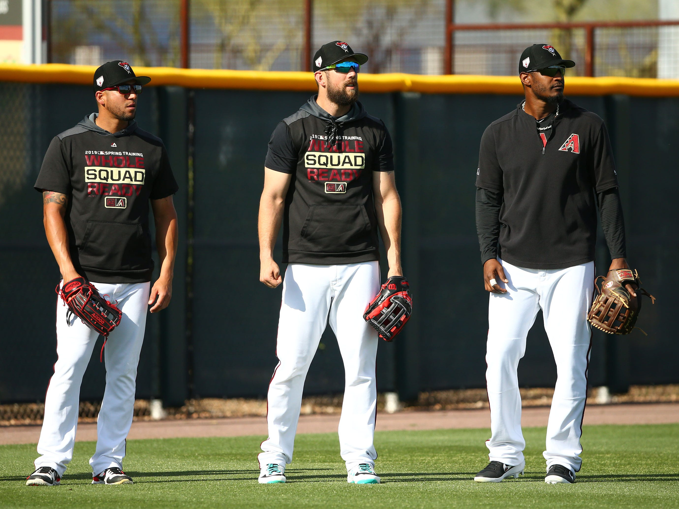 Arizona Diamondbacks outfielders David Peralta, Steven Souza Jr. and Adam Jones during spring training work-outs on Mar. 19, 2019 at Salt River Fields in Scottsdale, Ariz.