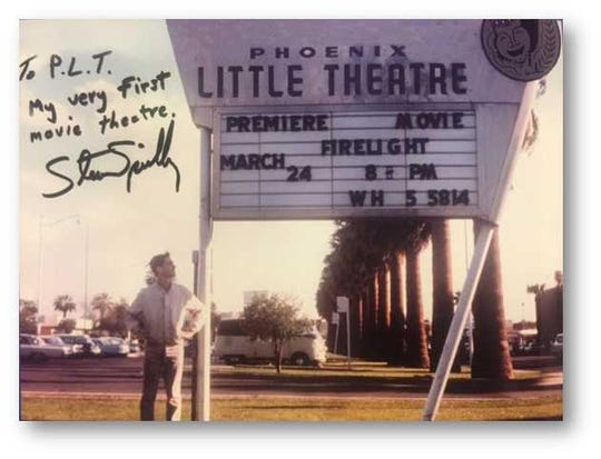 """Steven Spielberg standing in front of Phoenix Theatre for the debut of his first movie, """"Firelight,"""" when he was in high school."""