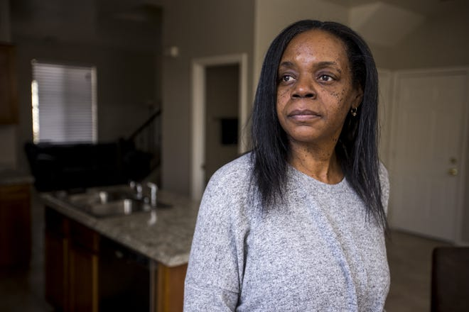 Denise Robinson-Kinney poses for a portrait in her home on Feb. 19, 2019, in Phoenix.