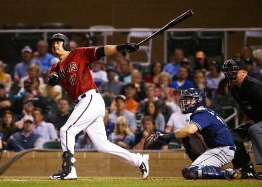 Arizona Diamondbacks Wilmer Flores (41) hits a RBI-sacrifice fly ball scoring David Peralta against the San Diego Padres in the first inning during a spring training game on Mar. 19, 2019 at Salt River Fields in Scottsdale, Ariz.