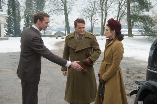 """In """"The Aftermath,"""" Stephen (Alexander Skarsgård) reaches out to meet Lewis (Jason Clarke) and Rachael (Keira Knightley)."""