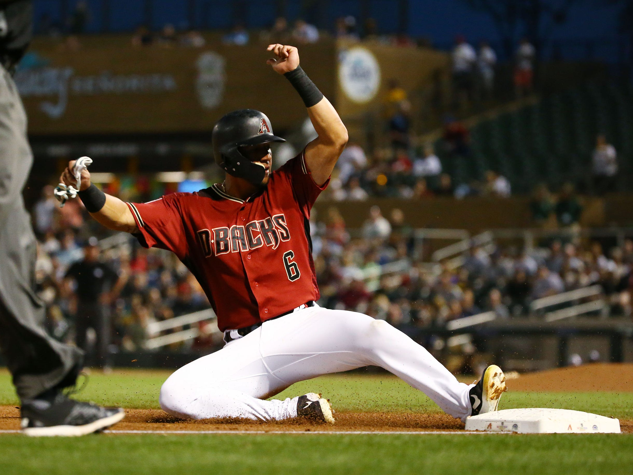 Arizona Diamondbacks David Peralta steals third base against the San Diego Padres in the first inning during a spring training game on Mar. 19, 2019 at Salt River Fields in Scottsdale, Ariz.