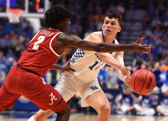 Kentucky guard Tyler Herro (14) passes around Alabama guard Kira Lewis Jr. (2) during the first half of an SEC Tournament game at Bridgestone Arena.
