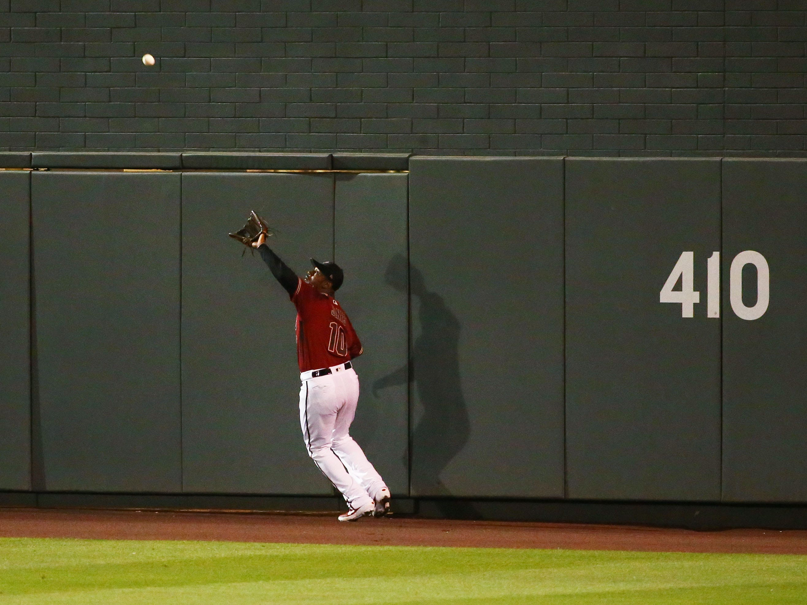 Arizona Diamondbacks center fielder Adam Jones (10) makes a catch on a ball hit by San Diego Padres Hunter Renfroe in the second inning during a spring training game on Mar. 19, 2019 at Salt River Fields in Scottsdale, Ariz.