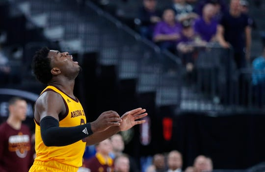 Arizona State's Luguentz Dort reacts after a play against Oregon during overtime of an NCAA college basketball game in the semifinals of the Pac-12 men's tournament Friday, March 15, 2019, in Las Vegas. (AP Photo/John Locher)