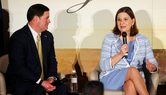 Ambassador of Mexico to the U.S., Martha Barcena, right, answers a question at the 2019 Arizona-Mexico Commission Governor's Luncheon, as Arizona Gov. Doug Ducey, left, listens Tuesday, March 19, 2019, in Phoenix.