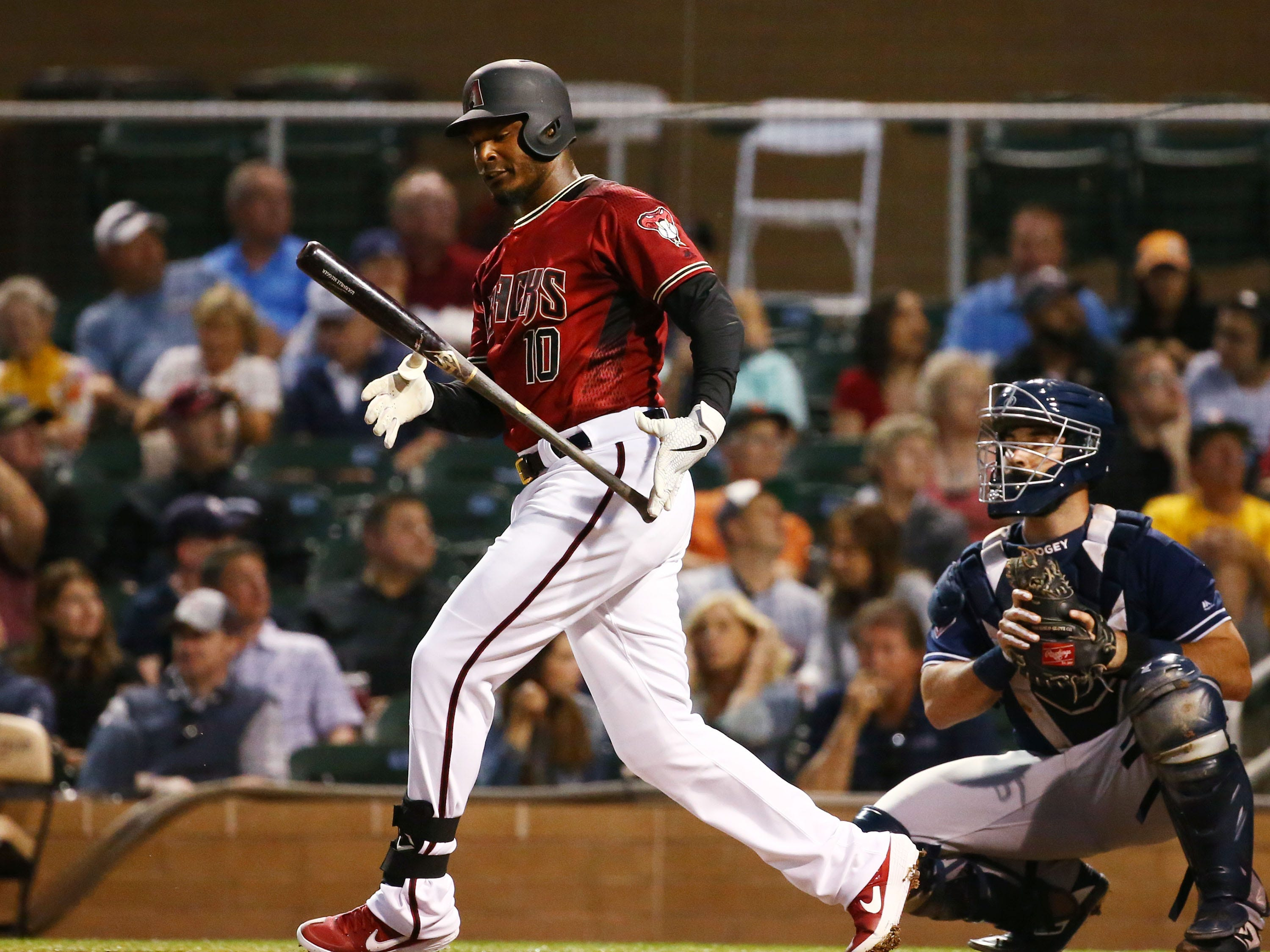 Arizona Diamondbacks center fielder Adam Jones (10) swings and misses against the San Diego Padres in the first inning during a spring training game on Mar. 19, 2019 at Salt River Fields in Scottsdale, Ariz.