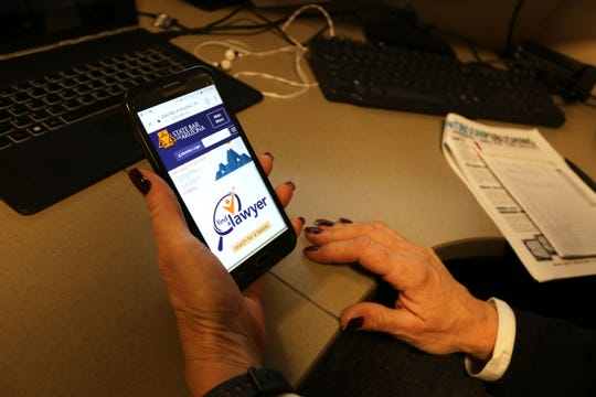 Cheryl Kulas, manager of the public service center at the State Bar of Arizona, accesses the Find-a-Lawyer site from her mobile phone. The state bar worked with LegalServicesLink, a private company, to create the digital platform.