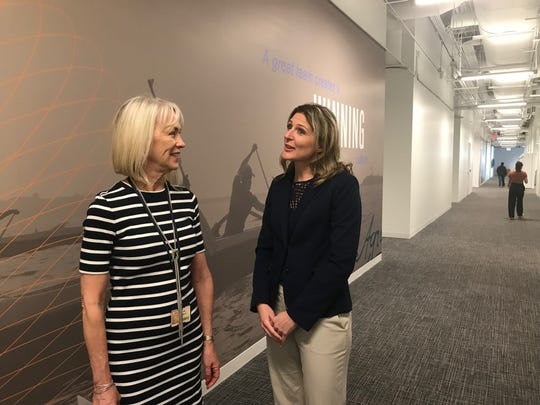 Chase executives Izma Miller (left) and Leslie Mulloy confer at the company's new south Tempe campus.