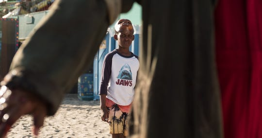 "Jason (Evan Alex) seems someone on the beach in ""Us."""