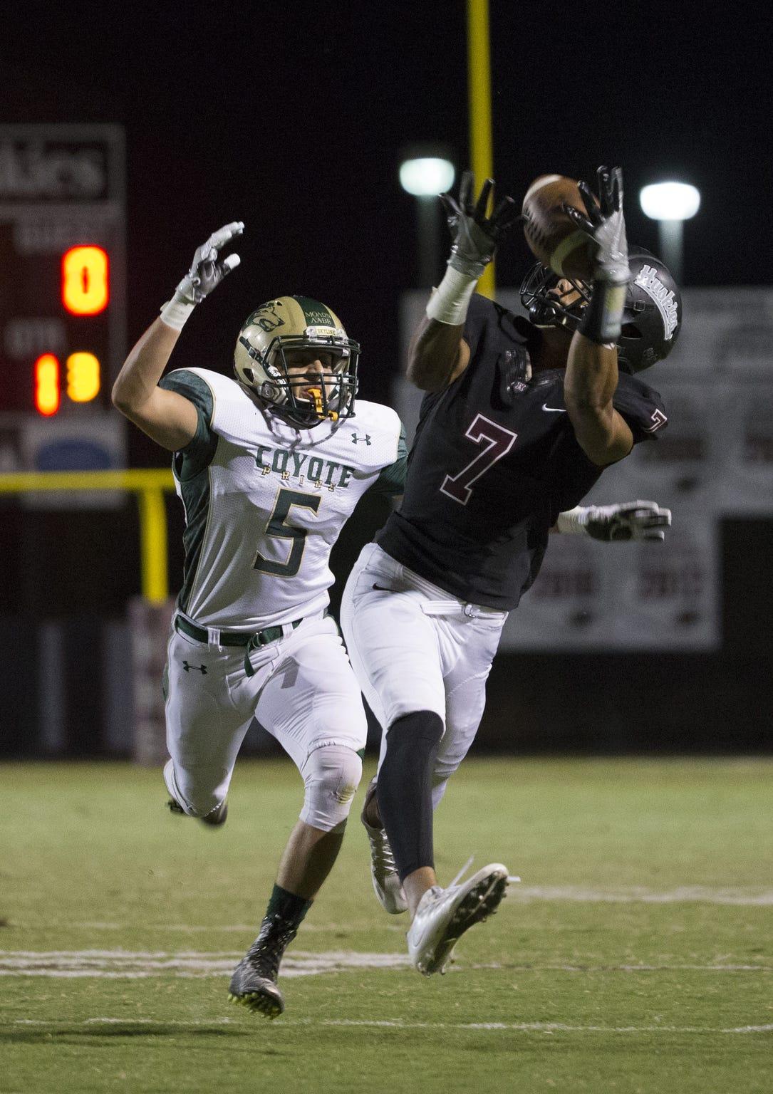 Hamilton's Chancellor Brewington (7) catches a pass against the defense of Skyline's Jacob Abramson (5) at Hamilton High School on September 23, 2016.