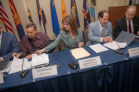 Tom Buschatzke, director of the Arizona Department of Water Resources, Bureau of Reclamation Commissioner Brenda Burman, John R. D'Antonio, Jr. of New Mexico and Norm Johnson of Utah sign a letter to Congress Tuesday seeking action on a Colorado River drought plan.