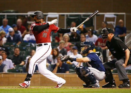 Arizona Diamondbacks center fielder Adam Jones (10) grounds-out against the San Diego Padres in the first inning during a spring training game on Mar. 19, 2019 at Salt River Fields in Scottsdale, Ariz.