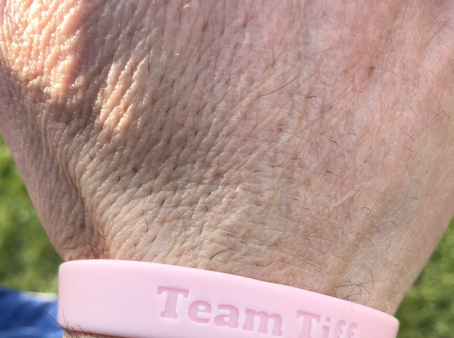 Cedar Crest athletes and coaches are wearing Team Tiff bracelets to support Tiffany Bare, Head Coach Rob Bare's wife, in her cancer fight. The boys and girls teams have dedicated the season to her.
