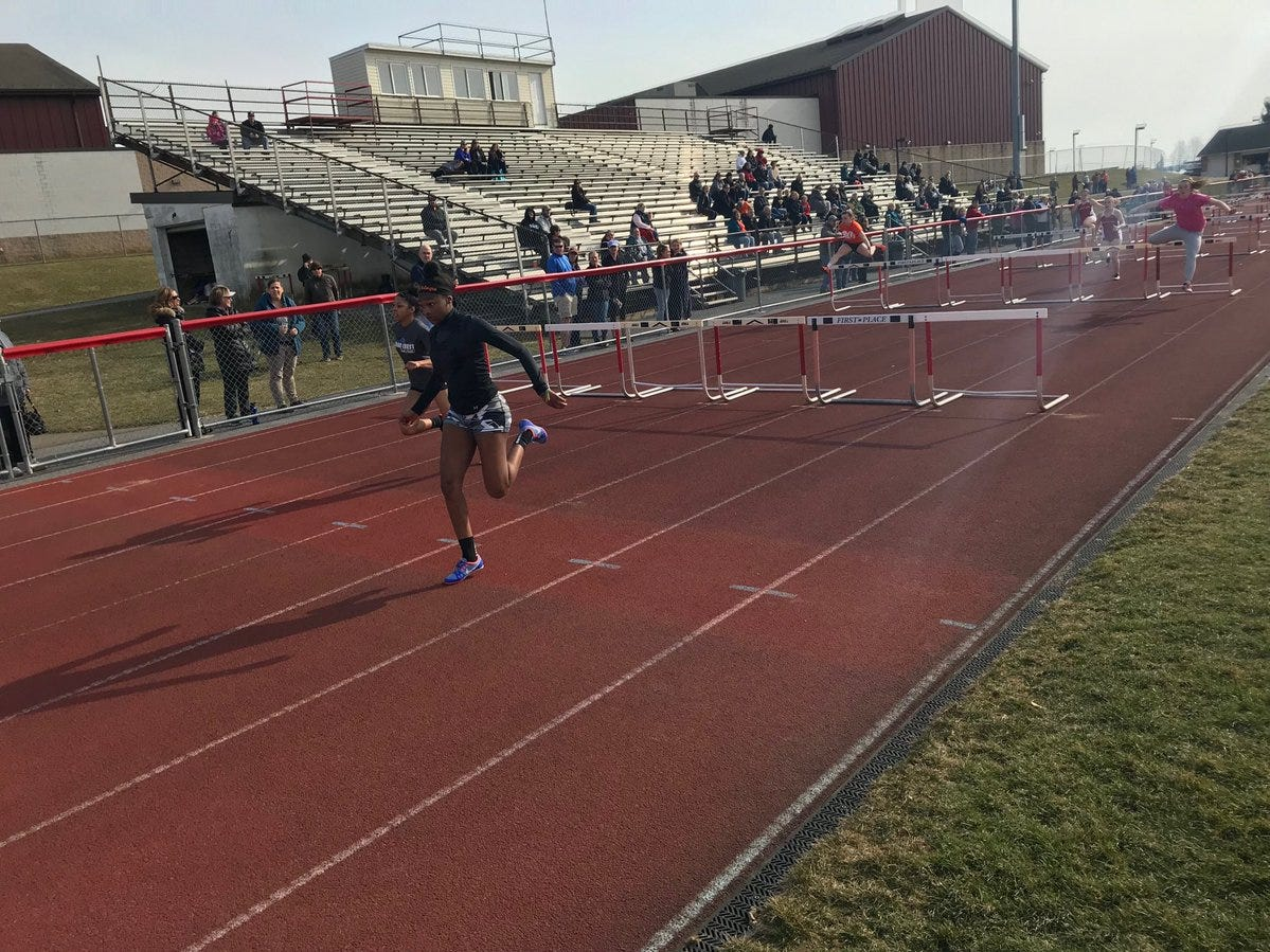 The race to the finish line of the girls 100 meter high hurdles.