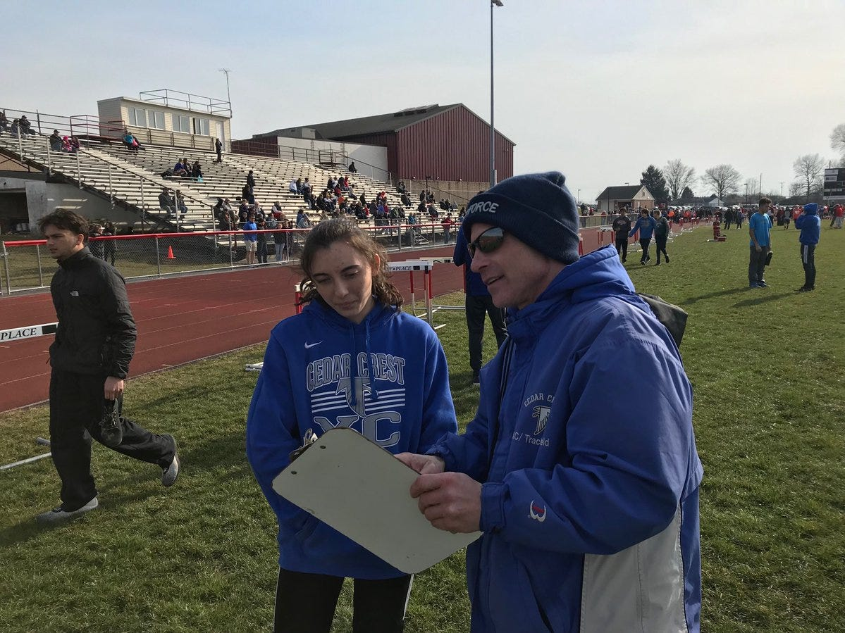 Cedar Crest track and field coach Rob Bare talks with sprinter Shayla Bonzelet