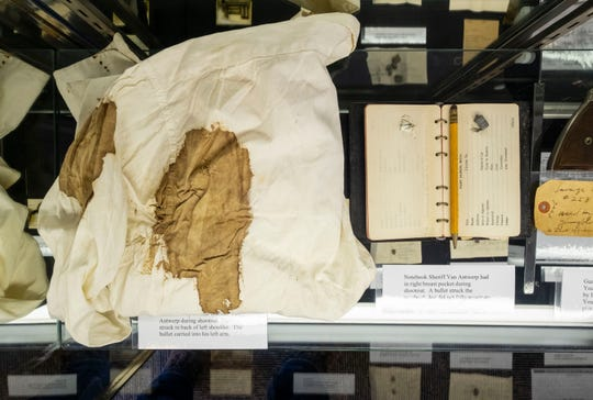 The bloody shirt of Sheriff William Van Antwerp sits next to a notebook carried by the sheriff in a glass case at the St. Clair County Sheriff's Office. Sheriff Van Antwerp was shot during a shootout with Herbert Youngblood in March 1934. A bullet struck him in the back of his left shoulder, while another bullet was stopped by the notebook, which he carried in his right breast pocket. Undersheriff Charles Cavanagh, who was also involved in the shooting, was killed, along with Youngblood, who was shot 10 times.
