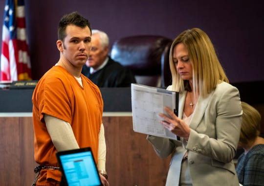 Joshua Bauman, left, passes by St. Clair County Senior Assistant Prosecuting Attorney Melissa Keyes as he is lead out of St. Clair County Circuit Judge Daniel Kelly's courtroom following a pre-trial hearing Wednesday, March 20, 2019. Bauman is being charged in the fatal shooting on Aug. 24 of Port Huron Police Lt. Joel Wood and wounding two others.
