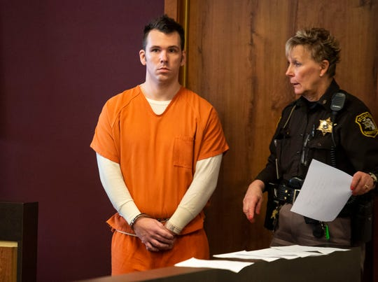 Joshua Bauman, left, waits before being lead into St. Clair County Circuit Judge Daniel Kelly's courtroom for a pre-trial hearing Wednesday, March 20, 2019. Bauman is being charged in the fatal shooting on Aug. 24 of Port Huron Police Lt. Joel Wood and wounding two others.