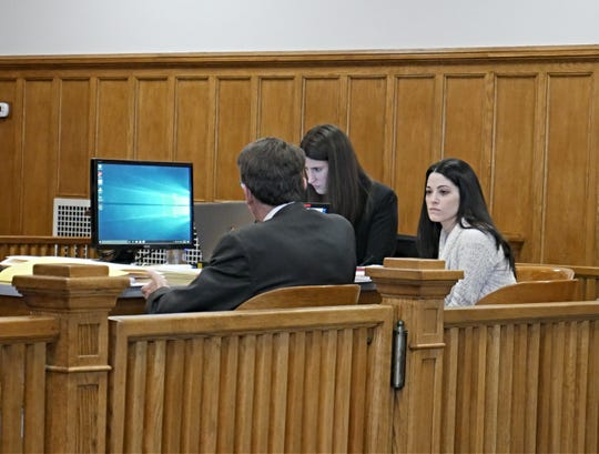 Nicole Addimando (beige sweater) sits with members of her defense team in Dutchess County Court on March 20, 2019.