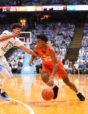 Syracuse Orange forward Elijah Hughes drives with the ball as North Carolina Tar Heels guard Cameron Johnson defends at Dean E. Smith Center.
