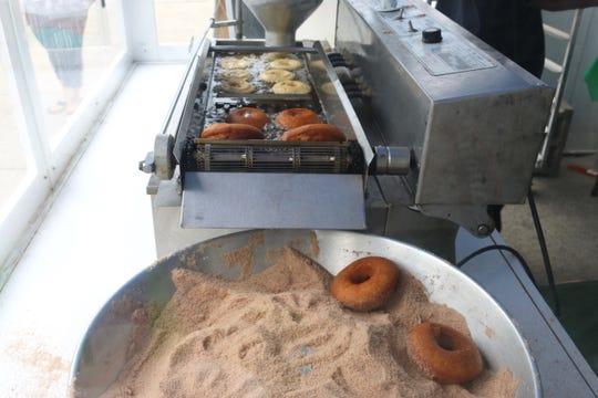 Apple cider doughnuts being prepared at Adams Fairacre Farms