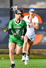 York College's Regan Cook, seen here at left in a file photo, is an NCAA Division III second-team All-American.
