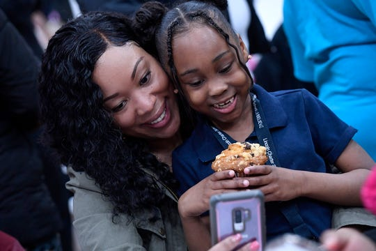 Tamar McMillian, left, takes a selfie with her daughter Ondia Thomas, 6, during the Lincoln Charter School Muffins with Mom program, Wednesday, March 20, 2019.