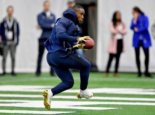 Penn State's Miles Sanders makes a catch during Penn State's Pro Day on Tuesday, March 19, 2019, in State College, Pa. (Abby Drey/Centre Daily Times via AP)